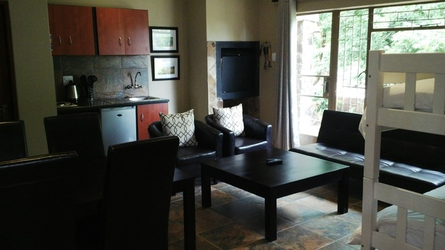 Super king studio lounge and dining area  - Treelands Abbey Dullstroom